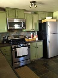 scenic wooden green kitchen cabinets with gray stone subway