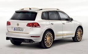 volkswagen touareg black volkswagen unveils special race 24 carat gold touaregs in qatar