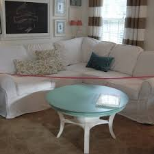 classic living room with white slipcover sectional couch and l