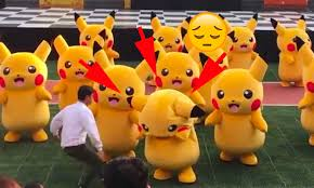 pikachu costume security guards hilariously drag a pikachu dancer stage after