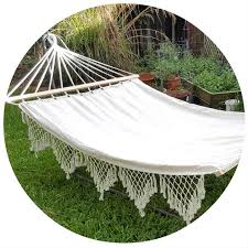 large white canvas hammock with spreader bar and tassels bho