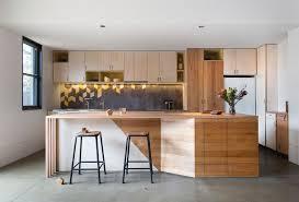 modern galley kitchen design blue painted cabinet brown teak wood