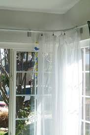 hanging curtains over sliding glass door how to hang curtain rods for a corner window for the home