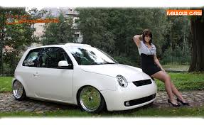 white volkswagen posing with a white volkswagen lupo vw lady model