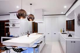 modern white kitchen decoration using black ball mirrored pendant