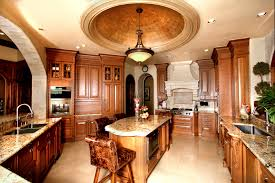 warm mediterranean kitchen with modern cream granite floor and