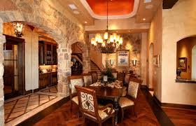 elegant formal dining room accented with stone arches domed