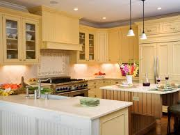 white and pale yellow buttermilk paint color for kitchen cabinet