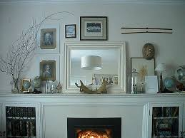 white fireplace mantels decorating with globe and mirror cast