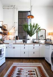 Rug In Kitchen With Hardwood Floor Industrial Style Kitchen With Hardwood Flooring And Patterned Rug