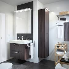 bathroom dark tile flooring plus wall mirror and oak wooden hung