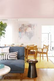 a living dining room gets a mid century makeover front main west elm family living diningroom makeover
