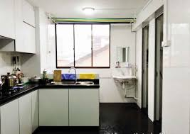 white kitchen island with black granite top design for one room kitchen flat with white wooden cabinet and