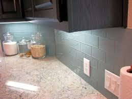elegant backsplash kitchen tile installation with blue wall
