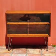 square mid century modern media console with glass door and