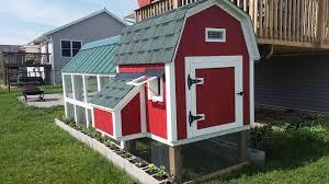 barn style coop with 4x10 run in a suburban neighborhood