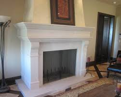 interior white fireplace with double white legs and brown brick