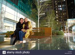 Cool Stock by Mixed Ethnic Couple Sit On Manhattan Bench In New York City On A
