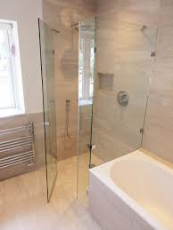 made to measure bespoke frameless shower ideas a bespoke overbath shower enclosure with frameless door and wet room flooring by room h2o