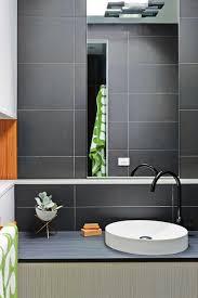 black tile bathroom ideas black tiles in bathroom ideas copper colored faucet metal