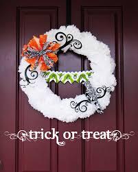 tissue paper pom pom halloween wreath tutorial positively