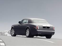 rolls royce phantom rear 2009 rolls royce phantom coupe rear angle road 1280x960