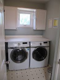 Laundry Room White Cabinets by Black Cabinet With Cream Marble Counter Top Combined With White