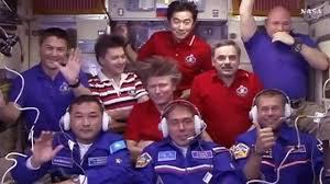 soyuz tma 18m crew opens hatch to the international space station