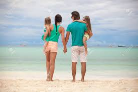 Beautiful Family Back View Of Beautiful Family With Two Daughters At Exotic Beach