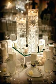 floating candle centrepiece reception photos pink and ivory floral