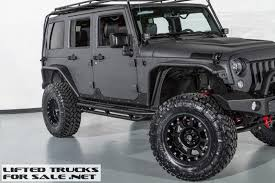 jeep wrangler jacked up matte black jeep wrangler unlimited rubicon kevlar coated lifted custom leather