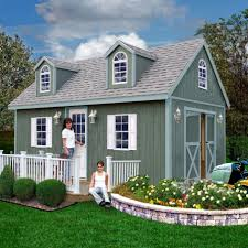 shipping container homes pictures with flowers and grass and