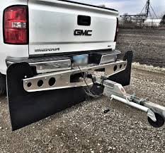 a gmc sierra pickup truck towing a trailer the trailer is