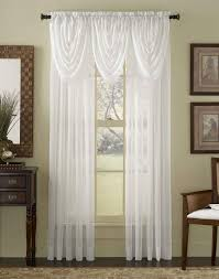 noble handmade scarf over valance and white curtains with wall