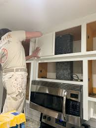 how to install cabinets with uneven ceiling tips for refinishing kitchen cabinets this house