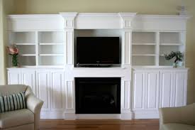 built in wall units around fireplace 6 image