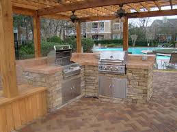 outdoor patio kitchen design with red brick herringbone floor f shocking l shape cabinet made of brick material with stove as good simple patio outdoor kitchen interior design