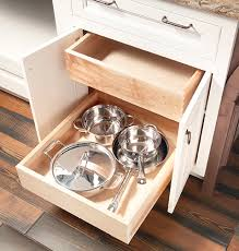kitchen cabinet pull out storage racks pull out storage space saving ideas wellborn cabinet