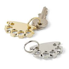 baby keychains babyknucks bottle opener keychain thinkgeek