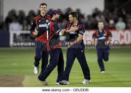 geraint jones of kent is bowled out by greg smith who celebrates
