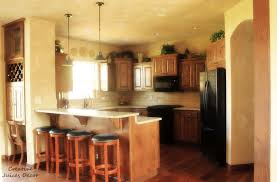 Photos Space Above Kitchen Cabinet Decorating Ideas Yeolab - Kitchen cabinet decor