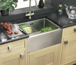 decorating corian countertop with stainless steel farmhouse sink