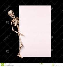 halloween background long skeleton holding empty blank over black halloween stock photo