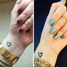 new small heart tattoos designs on wrist with names
