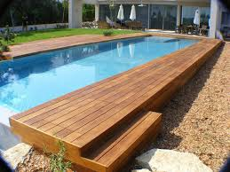swimming pool oval above ground pool with wooden deck and