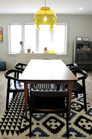 Yellow Pendant Lights Midcentury Modern Dining Room With Globe Pendant Light Wood Table