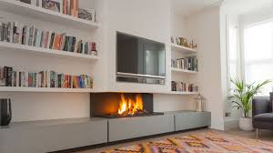 why not combine two focal points and install a tv above a fireplace the 572 tv contemporary modern gas fireplace is a masterpiece of form and function