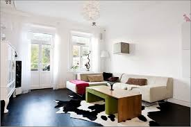 cowhide rug living room ideas black cowhide rug with white wall paint colors for elegant living