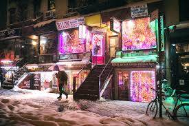 new york city winter night with east village lights in the snow