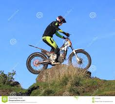 motocross bikes for sale scotland trial motorcyclist standing on bike on rock silhouette against